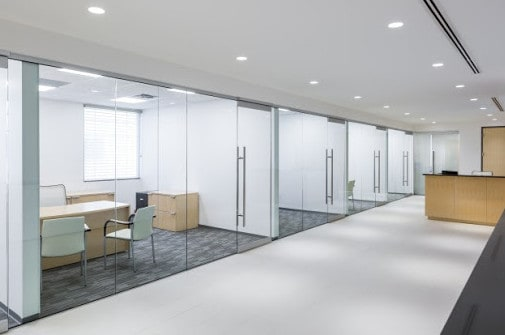 framed and frameless glass partitions for an office